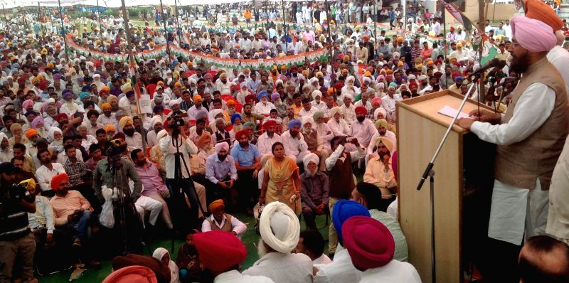Punjab Congress chief Partap Singh Bajwa and party's candidate from Gurdaspur addresses a rally at Kalanaur in Gurdaspur of Punjab on April 18, 2014.