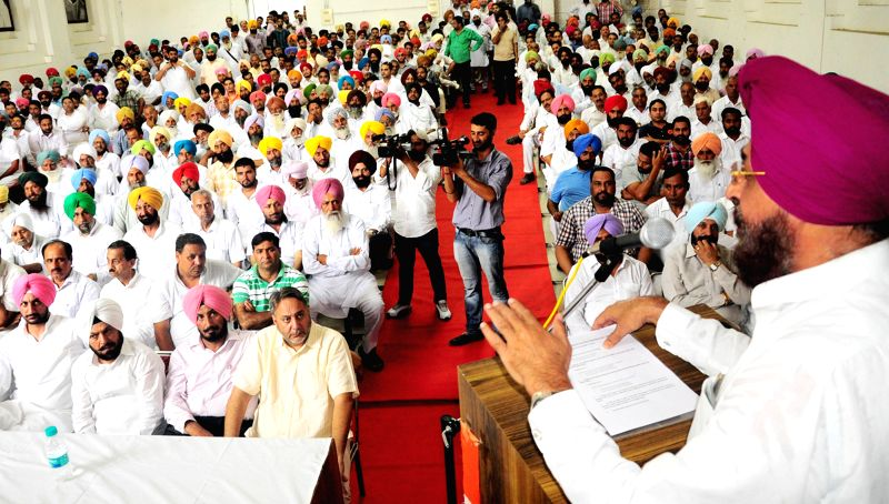 Punjab Congress President Partap Singh Bajwa addresses during a Congress programme in Chandigarh on July 15, 2014. - Partap Singh Bajwa