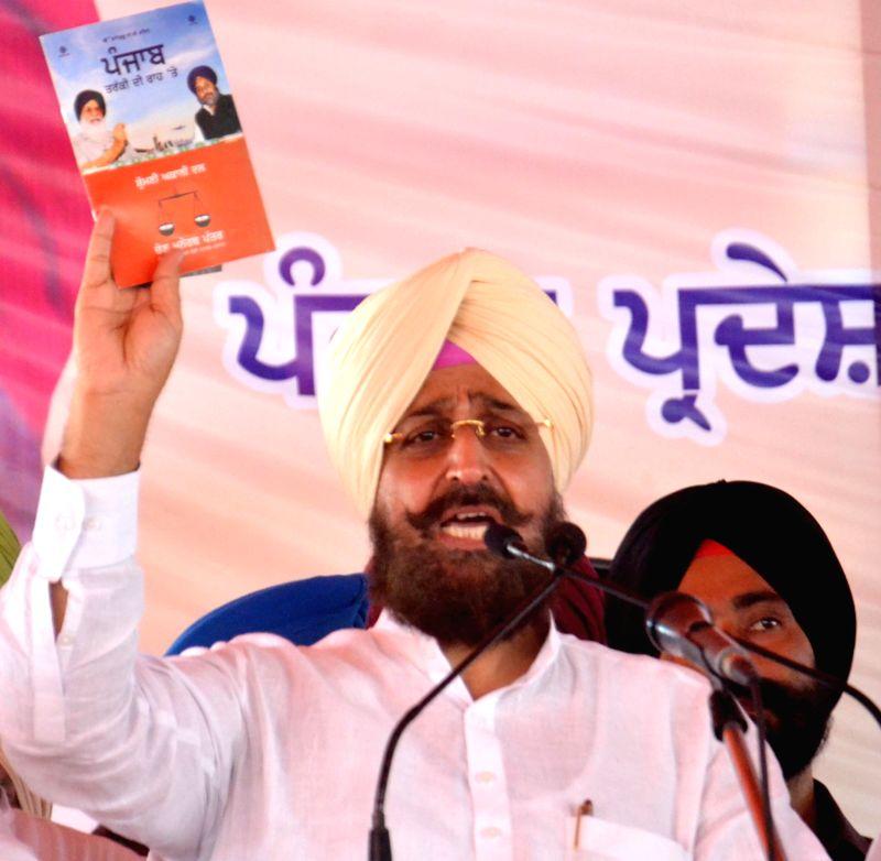 Punjab Congress President Partap Singh Bajwa addresses during a rally organised during Rakhar Punia fair at Baba Bakal, near Amritsar  on Aug 10, 2014.