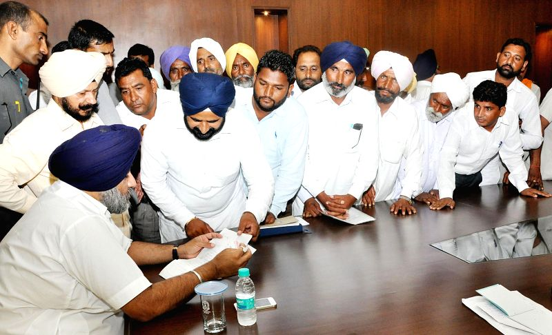 Punjab Deputy Chief Minister Sukbir Singh Badal resolving the public grievances during his Sangat Darshan program at Punjab Bhawan, New Delhi on Aug. 30, 2014.