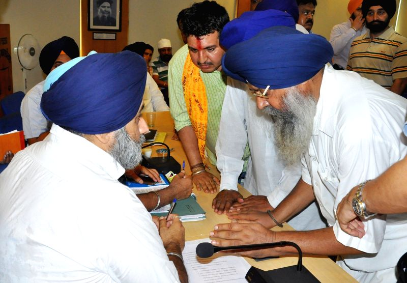 Punjab Deputy Chief Minister Sukhbir Singh Badal meets people during a programme in Chandigarh on June 18, 2014. - Sukhbir Singh Badal