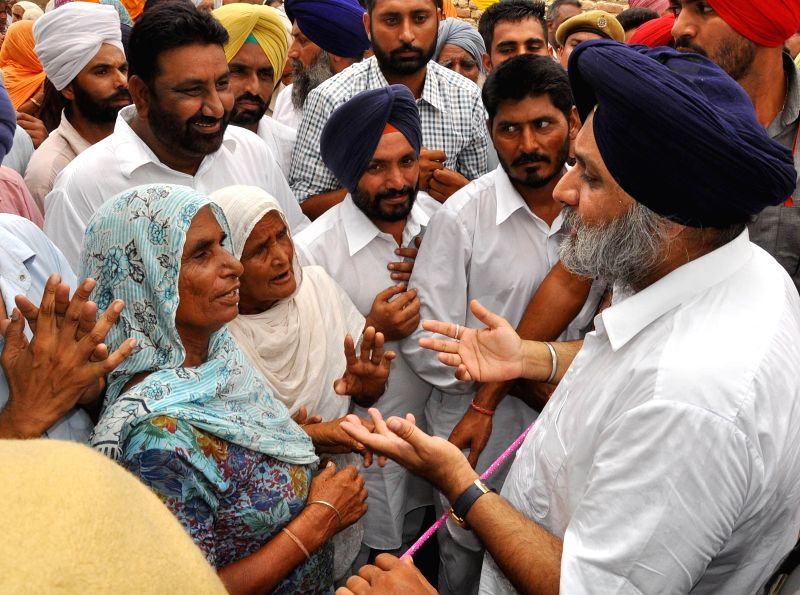 Punjab Deputy Chief Minister Sukhbir Singh Badal interacts with people during a rally at Talwandi Sabo in Bhatinda of Punjab on Aug 7, 2014.