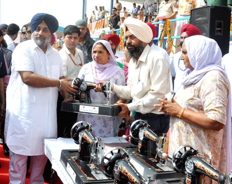 Punjab Deputy Chief Minister Sukhbir Singh Badal distributes sewing machines during Independence Day celebrations at Multi-purpose Sports Stadium in Bhatinda on Aug 15, 2014.