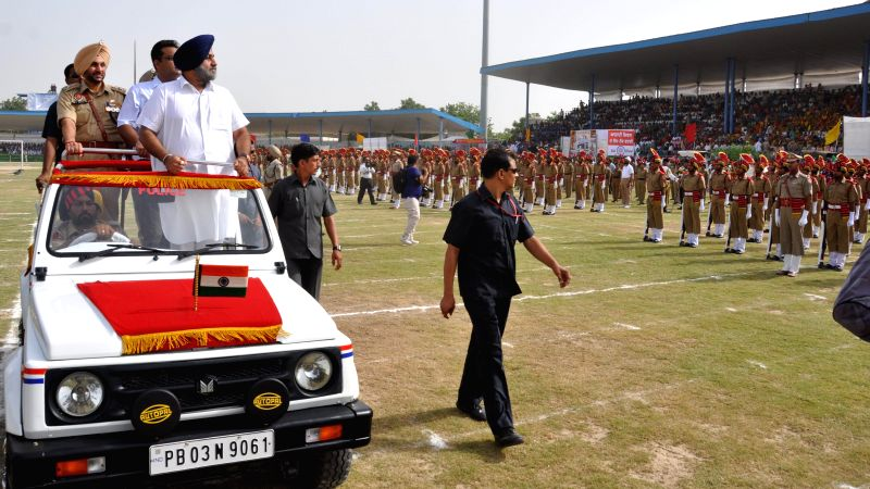 Punjab Deputy Chief Minister Sukhbir Singh Badal inspects Guard of Honour during Independence Day celebrations at Multi-purpose Sports Stadium in Bhatinda on Aug 15, 2014.