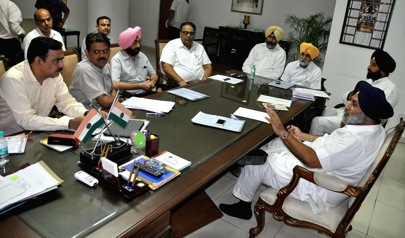 Punjab Deputy Chief Minister Sukhbir Singh Badal during a meeting with Punjab Rural Development and Panchayat Minister Sikander Singh Maluka, Punjab Renewable Energy Minister Bikram Singh Majithia ... - Sukhbir Singh Badal, Sikander Singh Maluka and Bikram Singh Majithia
