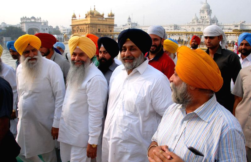 Punjab Deputy Chief Minister Sukhbir Singh Badal pays obeisance at the Golden Temple in Amritsar, on April 15, 2015.
