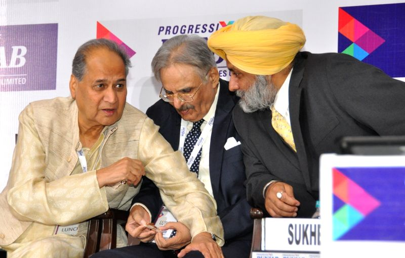 Punjab Deputy Chief Minister Sukhbir Singh Badal and Bajaj Auto Ltd chairman Rahul Bajaj during Progressive Punjab Summit in Mohali on Oct 28, 2015. - Sukhbir Singh Badal