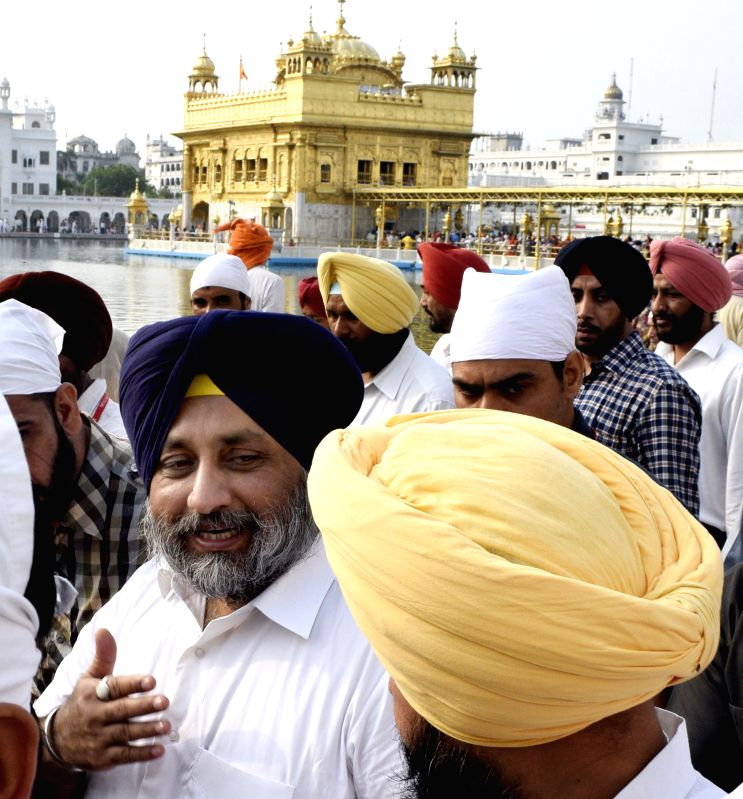Punjab Deputy CM Sukhbir Singh Badal paying obeisance at Golden Temple in Amritsar on August 2, 2014.