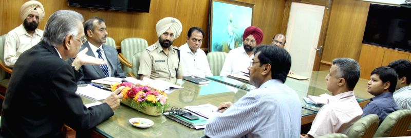 Punjab Governor and Administrator of Union Territory of Chandigarh, Shivraj V. Patil during a high level meeting with senior officials of Chandigarh Administration regarding supply of onions and ...