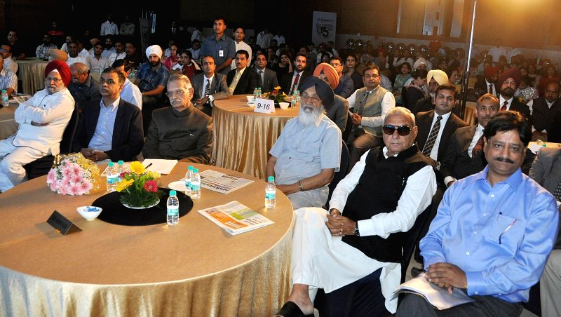 Punjab Governor Shivraj Patil, Punjab Chief Minister Parkash Singh Badal and Haryana Chief Minister Bhupinder Singh Hooda during a function in Chandigarh on May 15, 2014. - Shivraj Patil and Bhupinder Singh Hooda