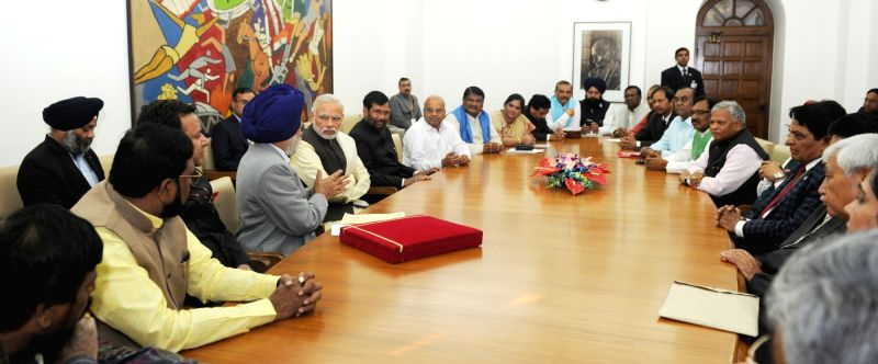 Punjab legislators call on Prime Minister Narendra Modi in New Delhi on Dec 11, 2015. - Narendra Modi