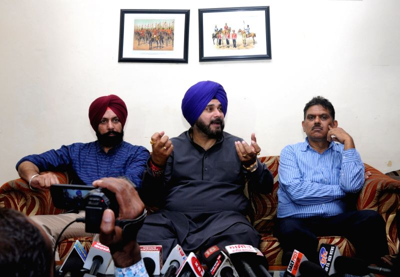 Punjab Minister Navjot Singh Sidhu addresses a press conference regarding Bus Rapid Transit System , in Amritsar, on July 13, 2018. - Navjot Singh Sidhu