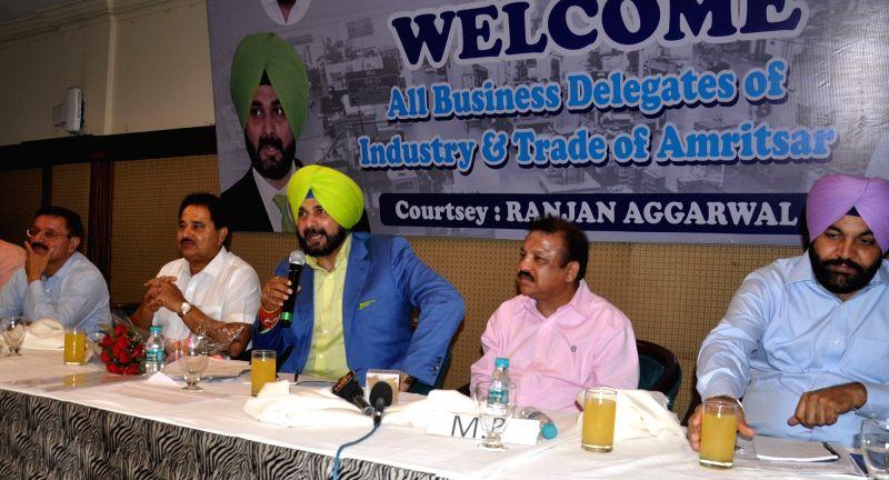 Punjab Minister Navjot Singh Sidhu during a meeting with business leaders in Amritsar, on June 4, 2017. - Navjot Singh Sidhu