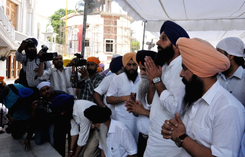 Punjab Revenue Minister Bikram Singh Majithia listens to atonement pronounced upon him by Sikh clergy at a Gurudwara in Amritsar on May 1, 2014. Majithia was for allegedly distorting the ...