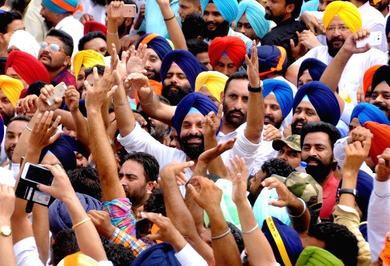 Punjab Revenue Minister Bikram Singh Majithia arrives at District Courts to file a defamation case against Delhi Chief Minister Arvind Kejriwal; in Amritsar on July 29, 2016. - Bikram Singh Majithia and Arvind Kejriwal
