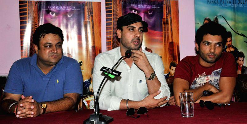 "Punjabi actor Gavie Chahal (in black cap) and Veer Vashisht and Karan during the promotion of their upcoming Punjabi film ""Paisa Yaar N Panga"" in Amritsar on July 5, 2014. - Gavie Chahal"
