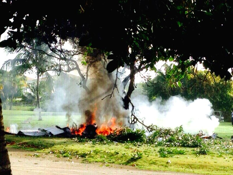Image provided by elinformador.net, taken with a mobile phone, of debris burning in the place of the accident of a plane, in Punta Cana, Dominican Republic, on ...