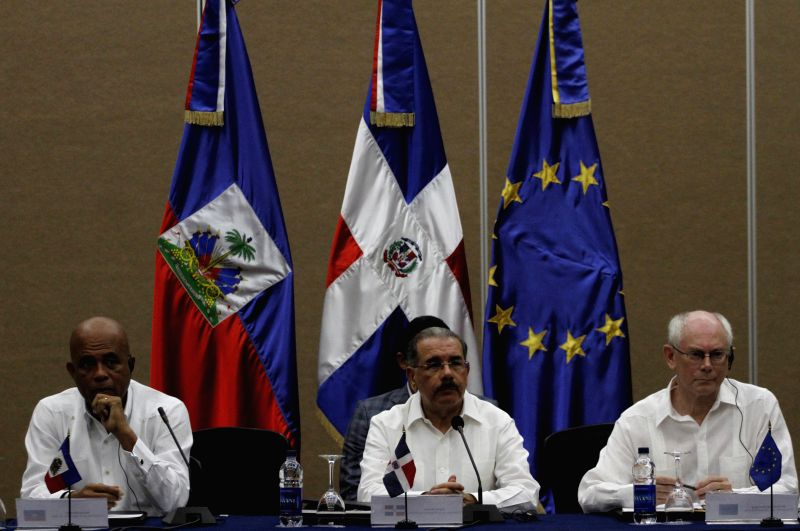 European Council President Herman Van Rompuy (R), Dominican Republic's President Danilo Medina (C) and Haiti's President Michel Martelly attend a trilateral ...