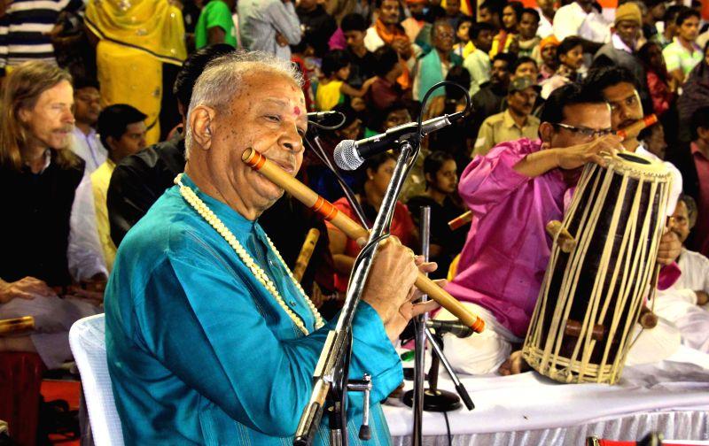 Indian classical flautist Hariprasad Chaurasia performs during Mahodadhi aatri at Puri beach, Odisha on Jan 5, 2015.
