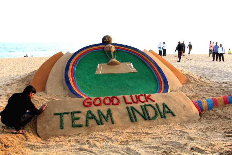 International sand artist Sudarshan Patanaik create a sand art on Cricket World cup 2015 in Puri on Feb. 2, 2015. - Sudarshan Patanaik
