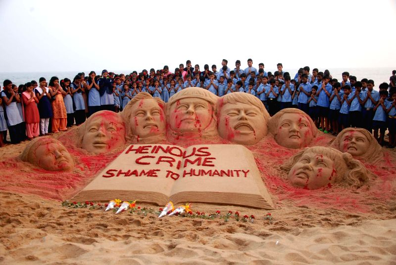 Noted sand artist Sudarshan Pattanaik's creation condemning the Tuesday's attack on the Army Public School in Peshawar, Pakistan, that claimed 104 lives mostly those of children, on Puri beach,