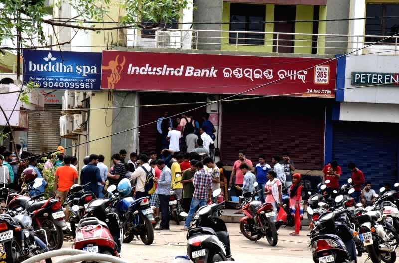 Puri: People queue-up outside an ATM in Puri on May 6, 2019.