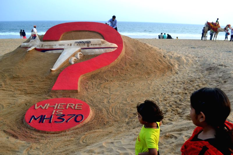 Renowned Indian sand artist Sudarsan Pattnaik's creation at Puri beach asks `Where is  (Malaysian plane) MH370 ?` an year after the mysterious disappearance of the aeroplane on March 8, 2015.