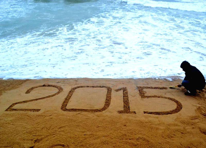 Renowned sand artist Sudarsan Pattnaik welcomes 2015 in Puri beach, Odisha on Dec 31, 2014.