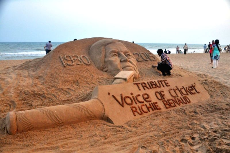 Renowned sand artist Sudarsan Pattnaik pays tribute to the former Australian cricketer Richie Benaud who died at the age of 84; in Puri, Odisha on April 10, 2015.