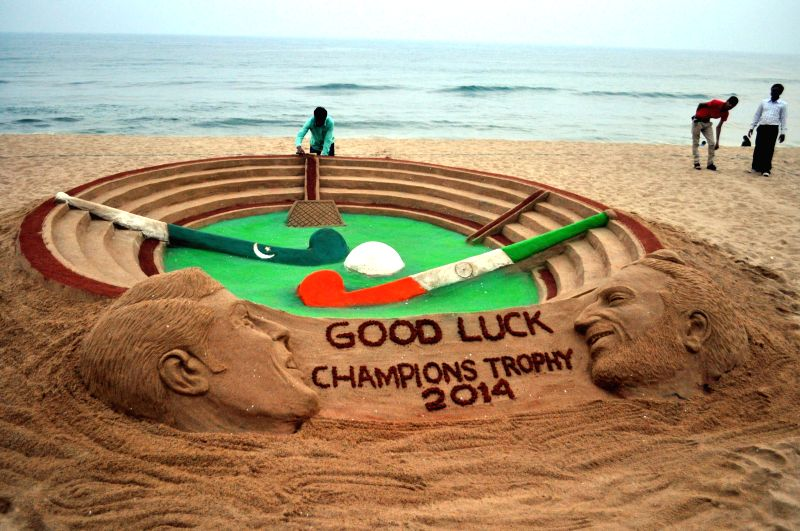Renowned sand artist Sudarsan Pattnaik's creation giving best wishes to both the Indian as well as Pakistan hockey teams ahead of HHCT - 2014 (Hero Hockey Men`s Champions Trophy 2014) semi ...