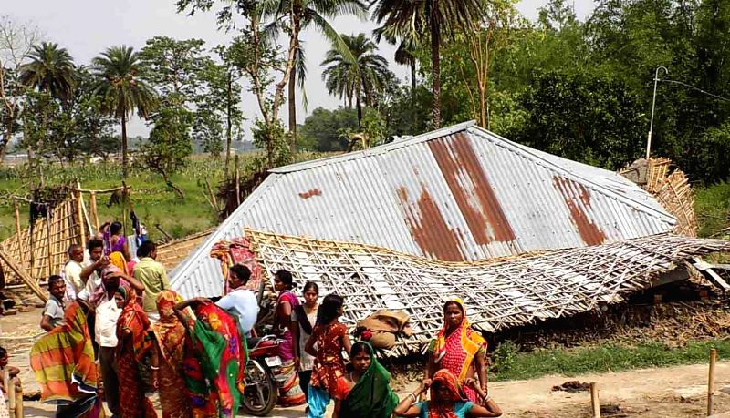 Destruction caused by a storm that lashed several districts of Bihar late on Tuesday night (22nd April 2015) in Purnia on April 22, 2015. At least 32 people have been killed and around 100 ...