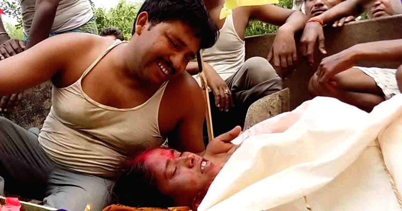 The relatives  of a lady who was killed in a storm that lashed several districts of Bihar late on Tuesday night (22nd April 2015) mourn her death in Purnia on April 22, 2015. At least 32 ...