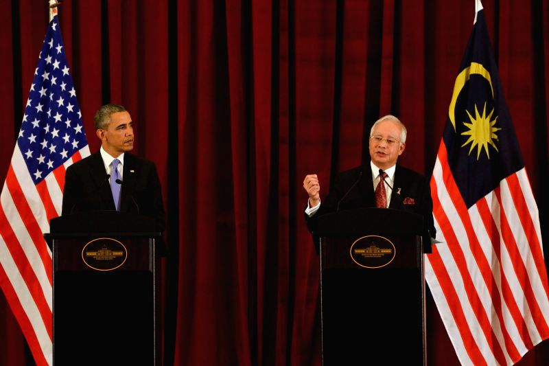 Visiting U.S. President Barack Obama (L) and Malaysian Prime Minister Najib Tun Razak hold a joint press conference in Putrajaya, Malaysia, on April 27, 2014. ... - Najib Tun Razak