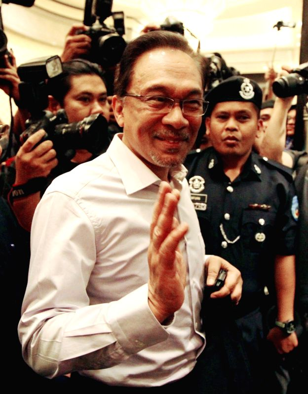 Photo taken on Feb. 10, 2015 shows Malaysian opposition leader Anwar Ibrahim at Malaysia's Federal Court in Putrajaya, Malaysia. Malaysia's Federal Court on ...