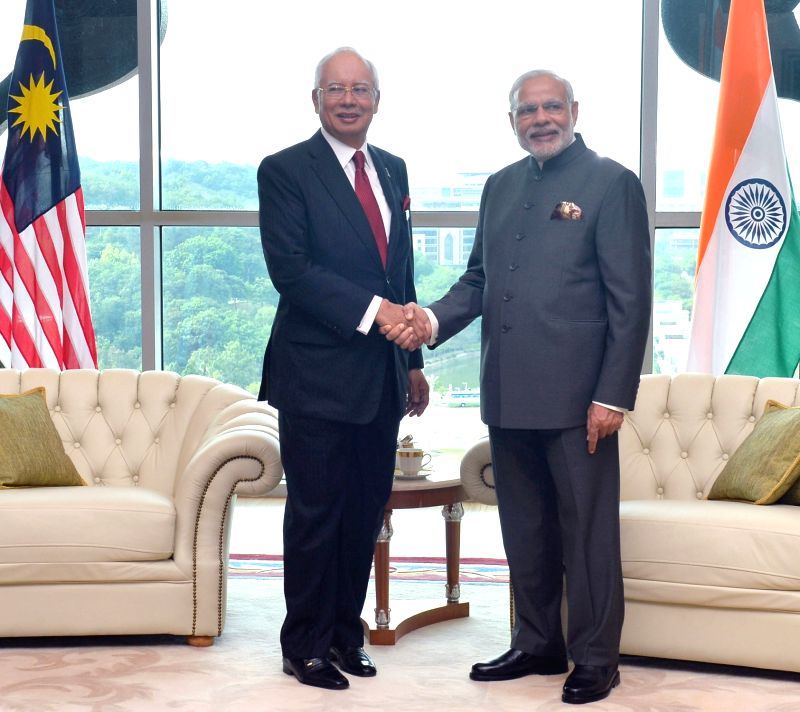 Putrajaya (Malaysia): Prime Minister Narendra Modi shakes hands with the Prime Minister of Malaysia Najib Razak before a restricted meeting, in Putrajaya, Malaysia on Nov 23, 2015. - Narendra Modi
