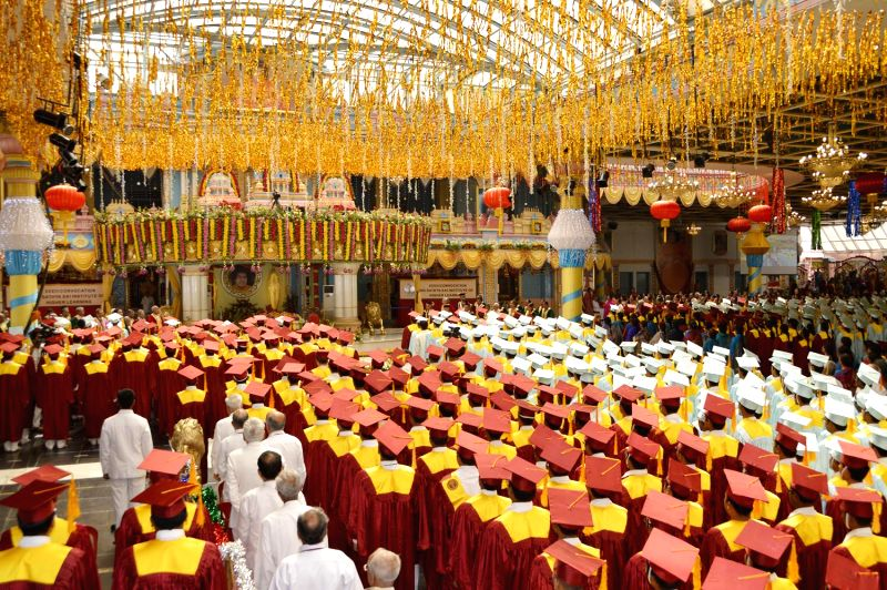 Devotees of Satya Sai Baba during a convocation organised on the eve of Satya Sai Baba`s 89th birth anniversary in Puttaparthi, Anantapur district of Andhra Pradesh on Nov 22, 2014.
