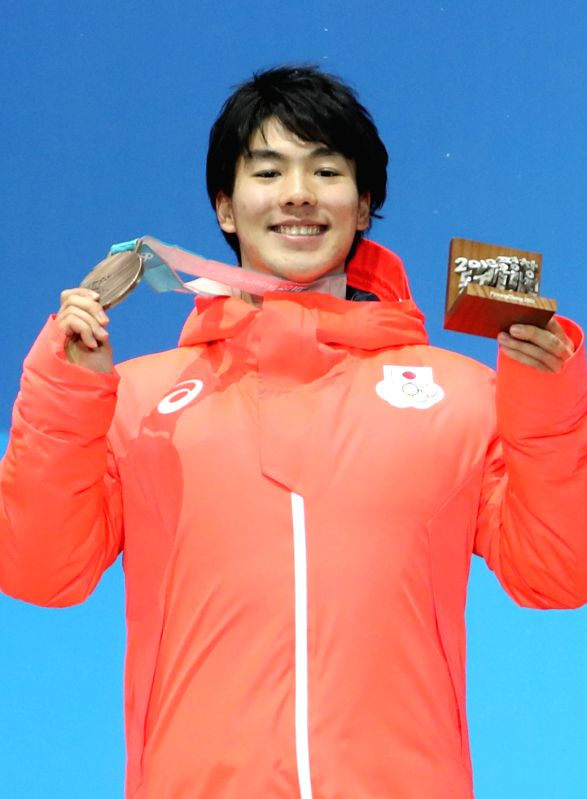 PYEONGCHANG, Feb. 13, 2018 - Bronze medalist Daichi Hara from Japan poses for photos during the medal ceremony of men's moguls event of freestyle skiing at 2018 PyeongChang Winter Olympic Games at ...