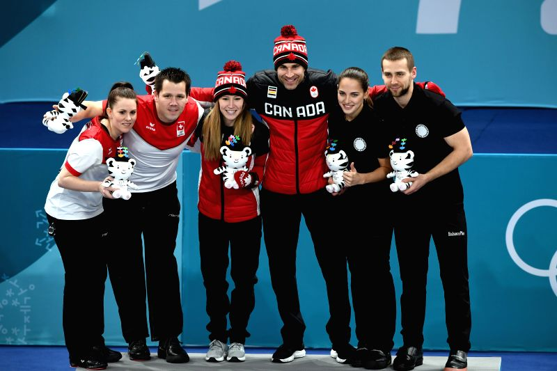 PYEONGCHANG, Feb. 13, 2018 - Champion Canada's Kaitlyn Lawes (3rd L) and John Morris (3rd R), second-placed Switzerland's Jenny Perret (1st L )and Martin Rios (2nd L) and third-placed Olympic ...