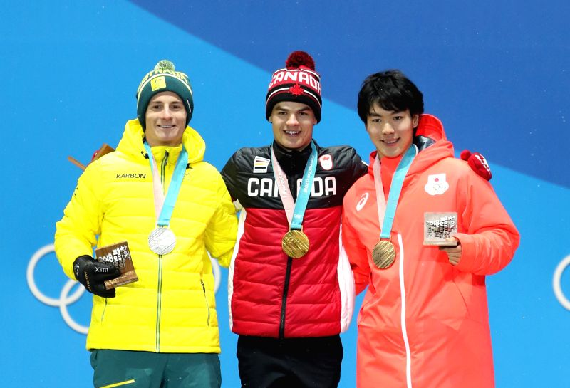 PYEONGCHANG, Feb. 13, 2018 - Champion Mikael Kingsbury from Canada (C), second-placed Matt Graham from Australia (L) and third-placed Daichi Hara from Japan pose for photos during the medal ceremony ...