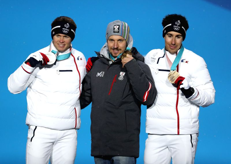 PYEONGCHANG, Feb. 13, 2018 - Gold medalist Marcel Hirscher (C) of Austria, silver medalist Alexis Pinturault (L) of France and bronze medalist Victor Muffat-Jeandet of France pose for photos during ...