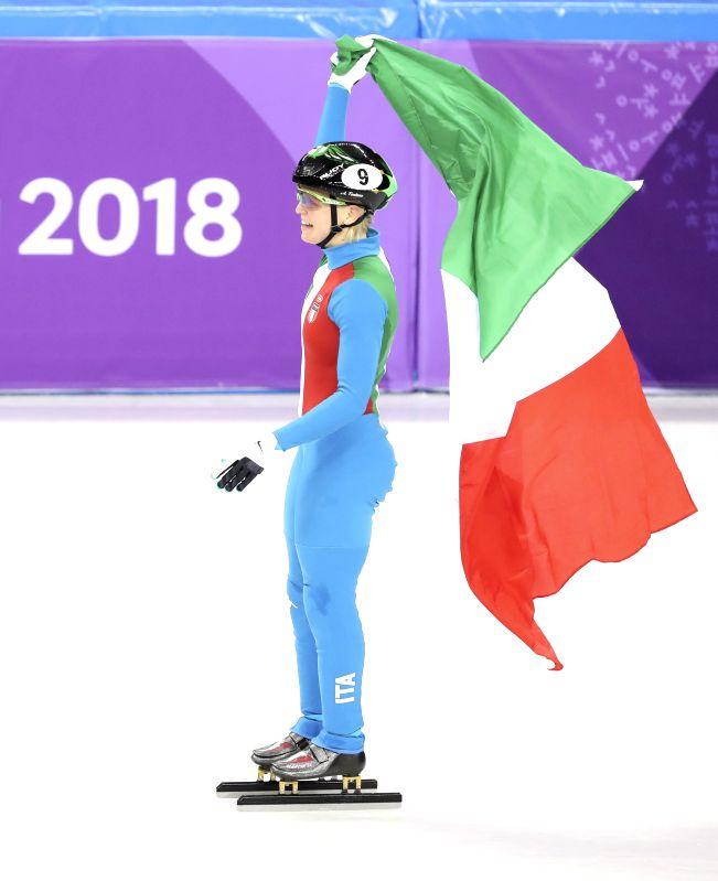 PYEONGCHANG, Feb. 13, 2018 - Italy's Arianna Fontana celebrates after finishing the ladies' 500m final of short track speed skating at the Pyeongchang 2018 Winter Olympic Games at Gangneung Ice ...
