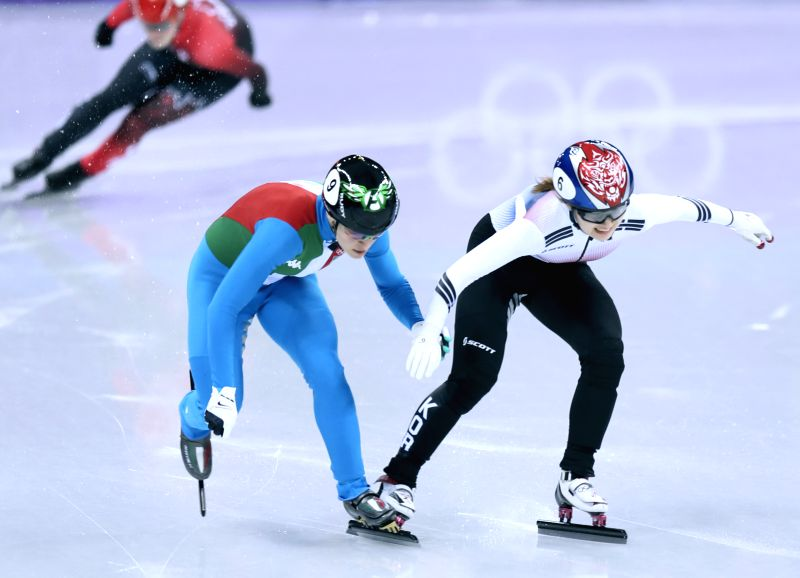 PYEONGCHANG, Feb. 13, 2018 - Italy's Arianna Fontana (L) collides with South Korea's Choi Minjeong during ladies' 500m final of short track speed skating at the Pyeongchang 2018 Winter Olympic Games ...