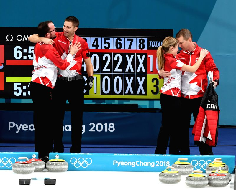 PYEONGCHANG, Feb. 13, 2018 - Kaitlyn Lawes (2nd R) and John Morris (2nd L) of Canada welcome congratulation after finishing the mixed doubles gold medal game of curling between Canada and Switzerland ...