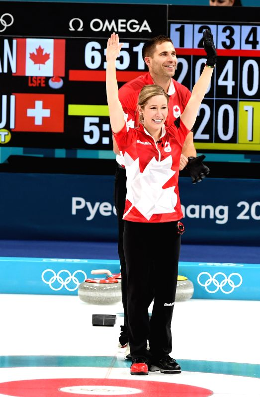 PYEONGCHANG, Feb. 13, 2018 - Kaitlyn Lawes (front) and John Morris of Canada celebrate after finishing the mixed doubles gold medal game of curling between Canada and Switzerland at the Pyeongchang ...