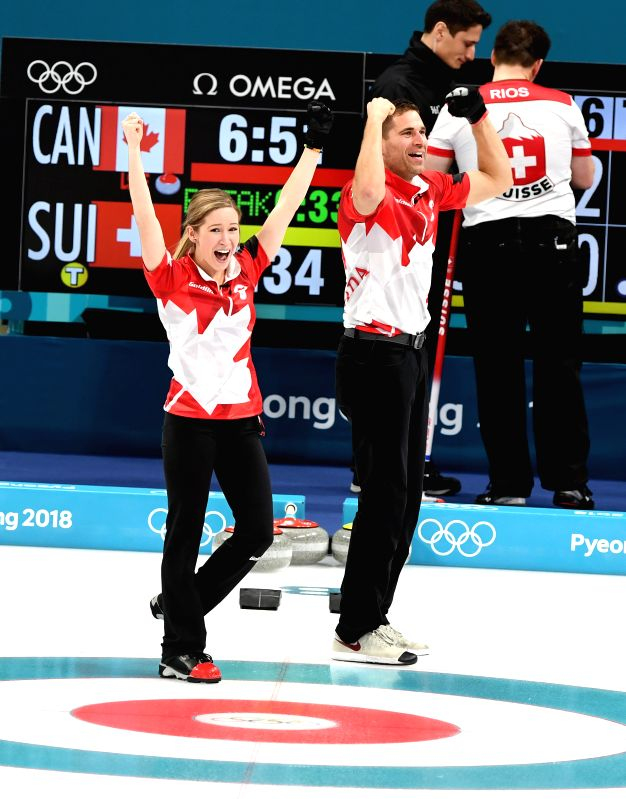 PYEONGCHANG, Feb. 13, 2018 - Kaitlyn Lawes (front L) and John Morris (front R) of Canada celebrate after finishing the mixed doubles gold medal game of curling between Canada and Switzerland at the ...