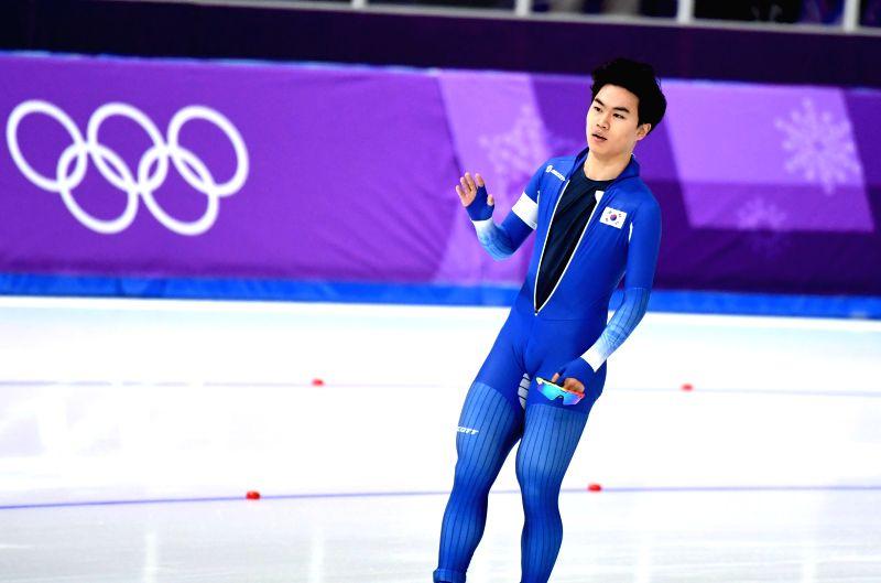 PYEONGCHANG, Feb. 13, 2018 - Kim Min Seok from South Korea reacts after finishing mens' 1500m event of speed skating at 2018 PyeongChang Winter Olympic Games at Gangneung Oval, Feb. 13, 2018. Kim Min ...