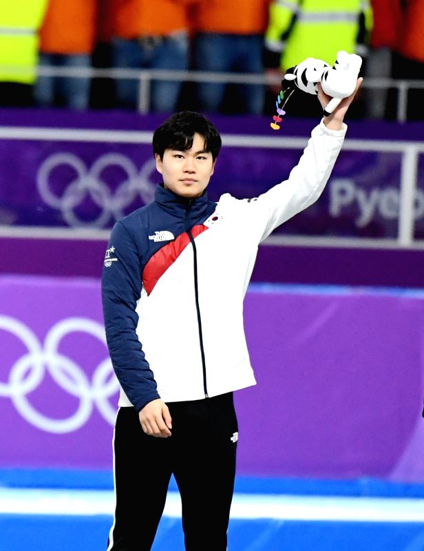 PYEONGCHANG, Feb. 13, 2018 - Kim Min Seok from South Korea poses for photos during venue ceremony of the mens' 1500m event of speed skating at 2018 PyeongChang Winter Olympic Games at Gangneung Oval, ...