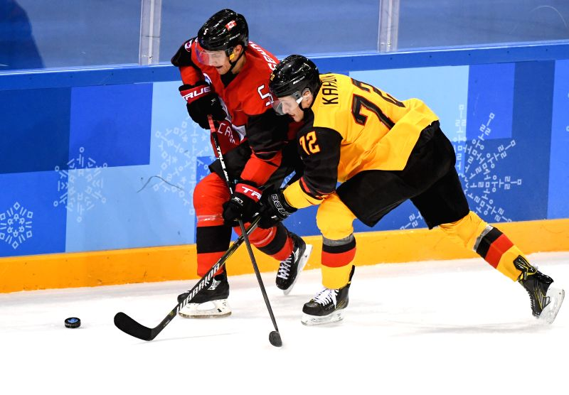 PYEONGCHANG Feb. 23 2018- Dominik Kahun of Germany defends Canada's Chay Genoway during a men's semi-final game of ice hockey at the 2018 Pyeong Chang Winter Olympic Games at Gangneung Ice