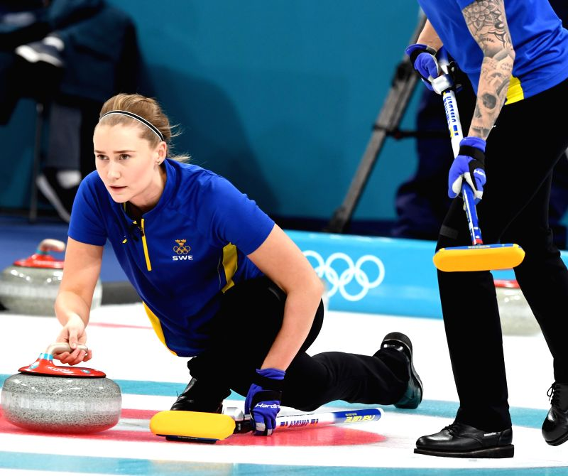 PYEONGCHANG, Feb. 23, 2018 - Sweden's Sara McManus (L) competes during a semi-final of women's curling against Britain at 2018 PyeongChang Winter Olympic Games at Gangneung Curling Centre, Gangneung, ...