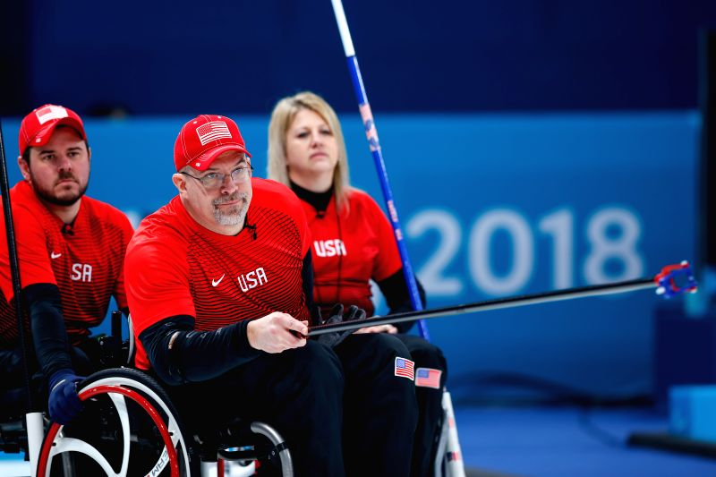PYEONGCHANG, March 13, 2018 - Steve Emt (front) from the United States competes during the match between the United States and China at the mixed round robin session 10 of wheelchair curling at the ...